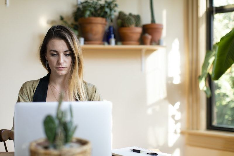 A woman sits at her laptop, reading her OCD test results and learning how to move forward.