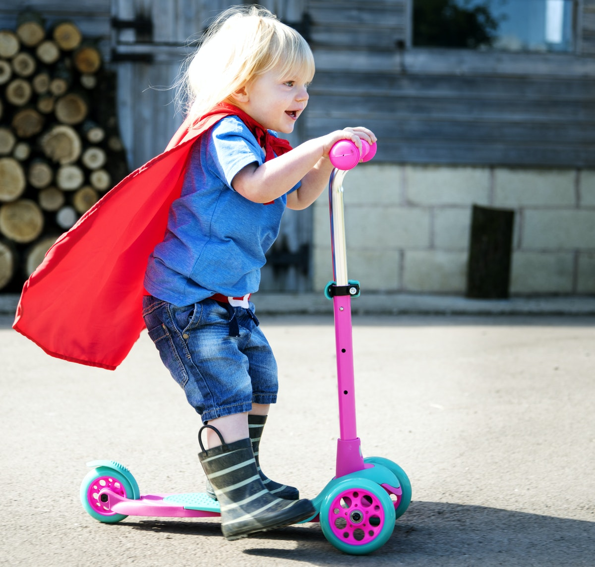 kid on scooter in costume