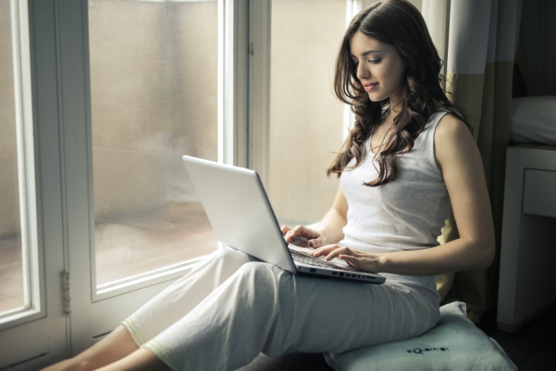 A woman chatting with strangers online, following safety guidelines including never revealing personal information.
