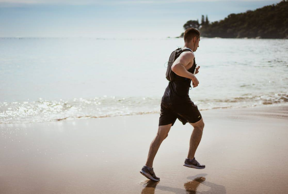A man is jogging by the beach. If you find yourself asking, why do