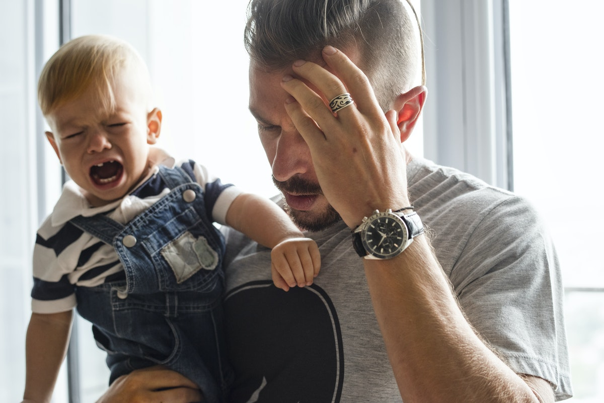Father and crying baby